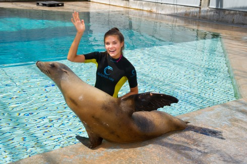 K. Lee Graham, Miss Teen USA 2014, interacts with Cassie the Sea Lion during a visit to Dolphin Cay at Atlantis, Paradise Island resort in The Bahamas.